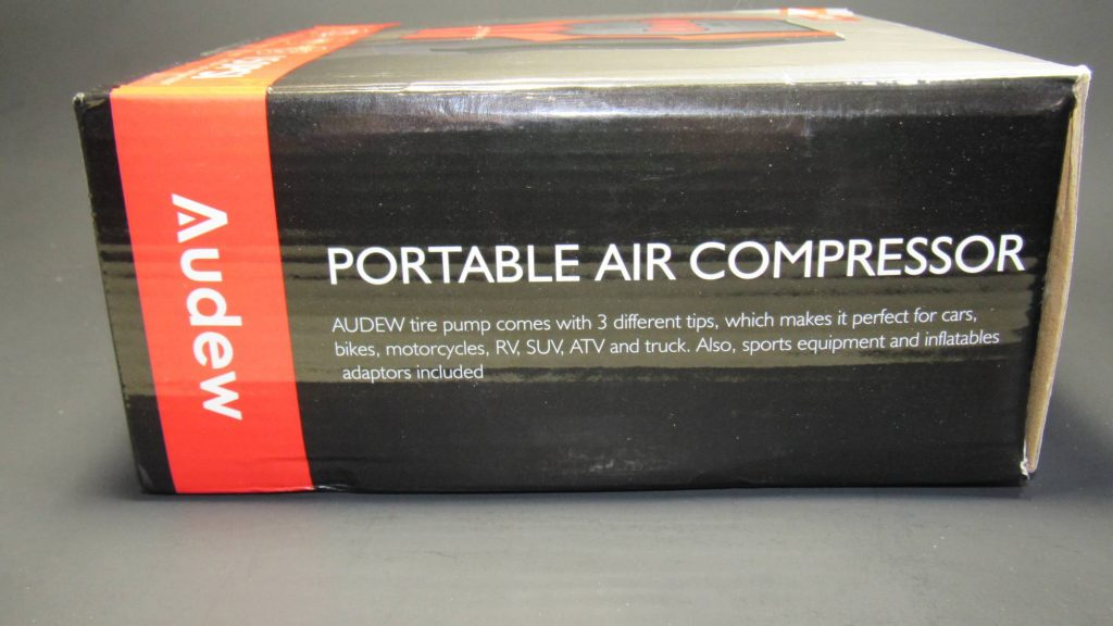 Side view of audew Air Compressor box. Red stripe with white logo, black box with white text